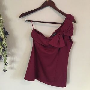 The Limited Asymmetrical Top